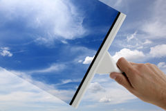 Clear blue sky. Using a squeegee to clear the blue sky above Stock Photography