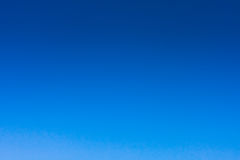 Clear blue sky. In blue Royalty Free Stock Photos