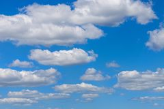 Clear blue sky background with clouds. Vibrant nature scene.  royalty free stock photo