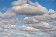 Clear blue sky background covered with lots of clouds. Vibrant nature scene stock photos