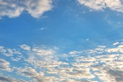 Clear blue sky background covered with lots of clouds. Vibrant nature scene royalty free stock photos