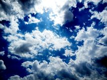 Clear blue sky with black and white cloud. stock images