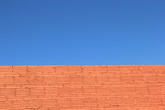 Clear blue sky brick wall Stock Image