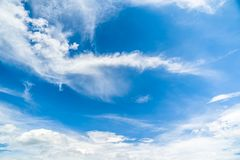 Clear Blue Sky with Clouds Background Stock Image
