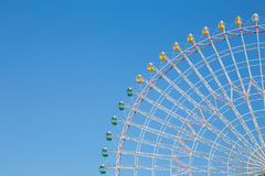 Clear blue sky over funfair ferris wheel. In fun park Royalty Free Stock Images