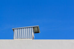 Clear blue sky with rooftop Royalty Free Stock Image