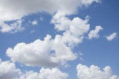 Clear blue sky and some clouds. The clear blue sky with some white clouds suny day stock photo