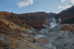 Clear blue sky and sulfur gas steaming out from ground at Noboribetsu Jigokudani or Hell Valley in Hokkaido, Japan. Place destination royalty free stock images