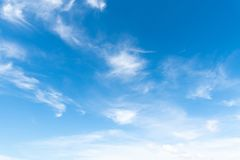 Clear blue sky with white cloud background. Clearing day. And Good weather in the morning stock image