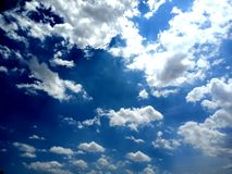 Clear blue sky with white cloud. royalty free stock photography