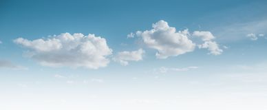 Clear blue sky and white clouds. Summer background royalty free stock image
