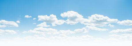 Clear blue sky and white clouds. Summer background royalty free stock images