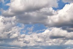 The clear blue sky with white clouds, closeup / Very fine weather with stratocumulus and cumulus clouds on a summer day. The clear blue sky with white clouds royalty free stock photo