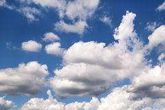 The clear blue sky with white clouds, closeup / Very fine weather with stratocumulus and cumulus clouds on a summer day. The clear blue sky with white clouds royalty free stock photography