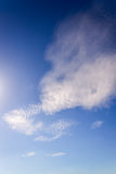 Clear blue sky and white clouds with sunshine daylight,  backgro Stock Photos