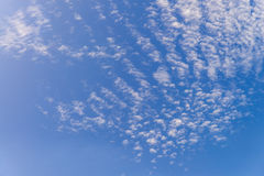 Clear blue sky and white clouds with sunshine daylight,  backgro Royalty Free Stock Photos