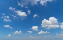 Clear blue sky with white fluffy clouds. Nature background stock photos