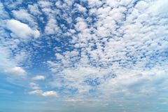Clear blue sky with white fluffy clouds. Nature background royalty free stock image