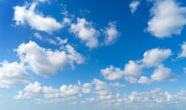 Free Clear Blue Sky With White Fluffy Clouds. Nature Background Stock Photography - 139851692