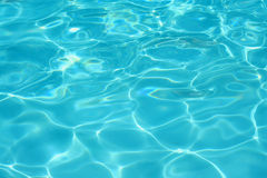 Clear blue swimming pool water Stock Images