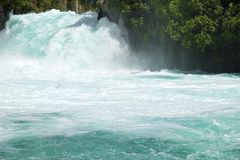 Clear Blue Waikato River Water Cascading Forcefully over Huka Falls Taupo New Zealand NZ. Just north of Taupo in Wairakei Park the Waikato River narrows. Water Stock Photo