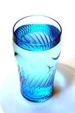 Clear Blue Water. A blue-tinted glass filled with drinking water Royalty Free Stock Photography