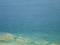 Clear blue Water of Lake Garda near Sirmione Stock Photo