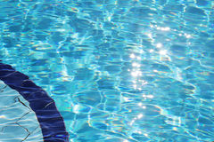 Sparkling clear blue water in swimming pool royalty free stock photography