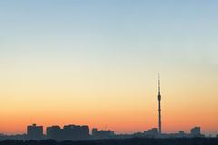 Clear blue and yellow sunrise sky over city Stock Photos