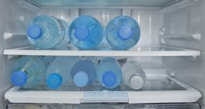 Clear bottles of clean fresh drinking water. Are refridgerated in a refridgerator to make and keep its coldness for drinking when people are thirsty royalty free stock photography