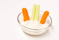Clear bowl of dip and veggies. Small clear glass bowl of dip and veggies Royalty Free Stock Photography