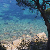 Clear bright Mediterranean rock beach in Costa Brava, Catalonia Royalty Free Stock Photo