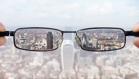 Clear business vision. Concept businessman looking at the financial district of the city of London royalty free stock photography