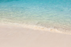 Clear and calm wave. Calm wave roll into white sand beach Stock Photos