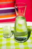 Clear carafe water. Clear carafe with water and a glass to drink Stock Photography