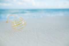 Clear christmas glass ball on beach. With seascape background Stock Images