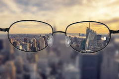 Clear cityscape focused in glasses lenses Stock Photography