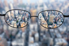 Clear cityscape focused in glasses lenses Royalty Free Stock Photography