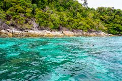 Clear and clean blue-green sea and the tourist are snorkeling. Beautiful tropical nature landscap, clear and clean turquoise sea and the tourist are snorkeling stock image