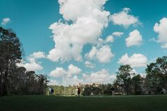 Clear Clouds in Orlando Florida. Clear clouds in a bright blue sky in Orlando Florida. Great day for golfing and being outside playing or having fun with friends stock image