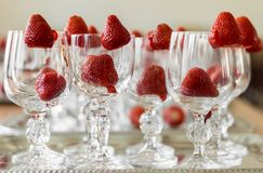 Strawberries decorate elegant crystal glasses royalty free stock images