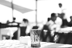 Clear Cut Glass Highball Drinking Glass at the Top of the Table Selective Focus Photography Stock Photography