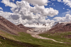 Clear day in the mountains of Kyrgyzstan. Mountain peaks, glaciers, mountain rivers, sunny weather Royalty Free Stock Photos