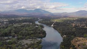 Aerial View Sacramento River Redding California Bully Choop Mountain. Clear Day to see wildfire damage over the Sacramento River in Near Sundial Bridge Redding stock video