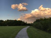 Clear day walking path. Walking trail path stock photos