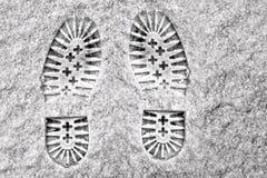 Clear deep footprints on white winter snow Stock Photos