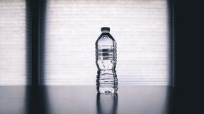 Clear Disposable Bottle on Black Surface Royalty Free Stock Photography