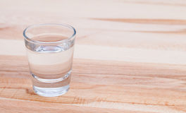 Clear drink on wood table Royalty Free Stock Photos