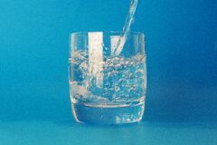 Clear Drinking Glass With Water Poured in royalty free stock photo
