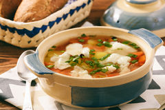 Clear fish soup with vegetables. Royalty Free Stock Photo
